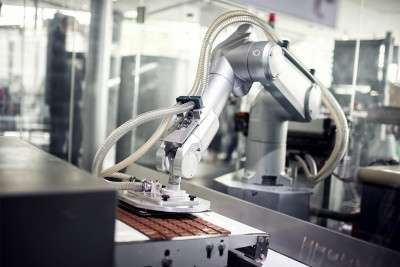 Robot working on assembly line that was engineered through automation and control engineering