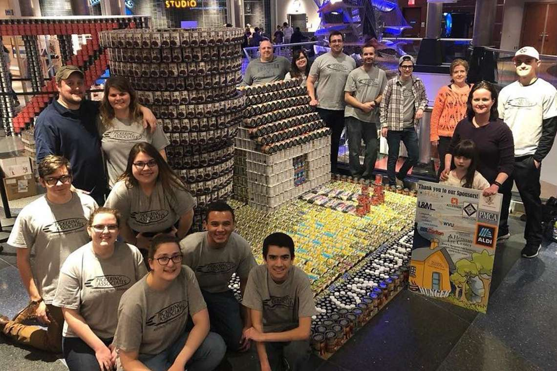 Cans put together to look like a house and a tornado